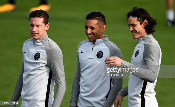 Paris SaintGermain's German midfielder Julian Draxler Paris SaintGermain's Brazilian defender Marquinhos and Paris SaintGermain's Uruguayan forward...