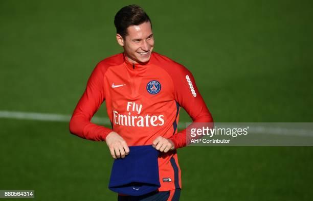 Paris SaintGermain's German midfielder Julian Draxler smiles during a training session on October 12 2017 at the Oredoo training center in...