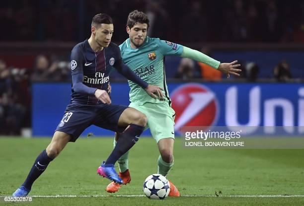 Paris SaintGermain's German midfielder Julian Draxler vies with Barcelona's Spanish midfielder Sergi Roberto during the UEFA Champions League round...