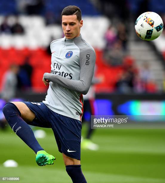Paris SaintGermain's German midfielder Julian Draxler warms up with teammates ahead of the French L1 football match between Paris SaintGermain and...