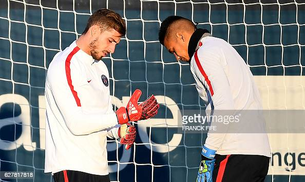 Paris SaintGermain's goalkeepers Kevin Trapp and Alphonse Areola take part in a training session on December 5 2016 in SaintGermainenLaye western...