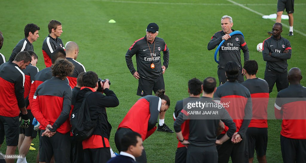 Paris Saint-Germain's head coach Carlo Ancelotti (C-back) speaks to his team during a training at the Aspire Academy of Sports Excellence in the Qatari capital Doha on December 31, 2012. PSG is in Qatar for a week-long training camp before the resumption of the French Ligue 1 after the winter break.