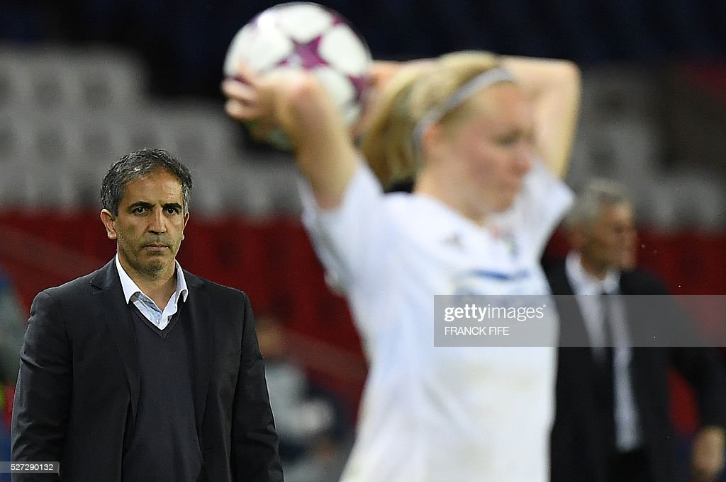 Paris Saint-Germain's head coach Farid Benstiti (L) attends the UEFA Women's Champions League semi-final second leg football match between Paris Saint-Germain (PSG) and Lyon at the Parc des Princes stadium in Paris on May 2, 2016. / AFP / FRANCK