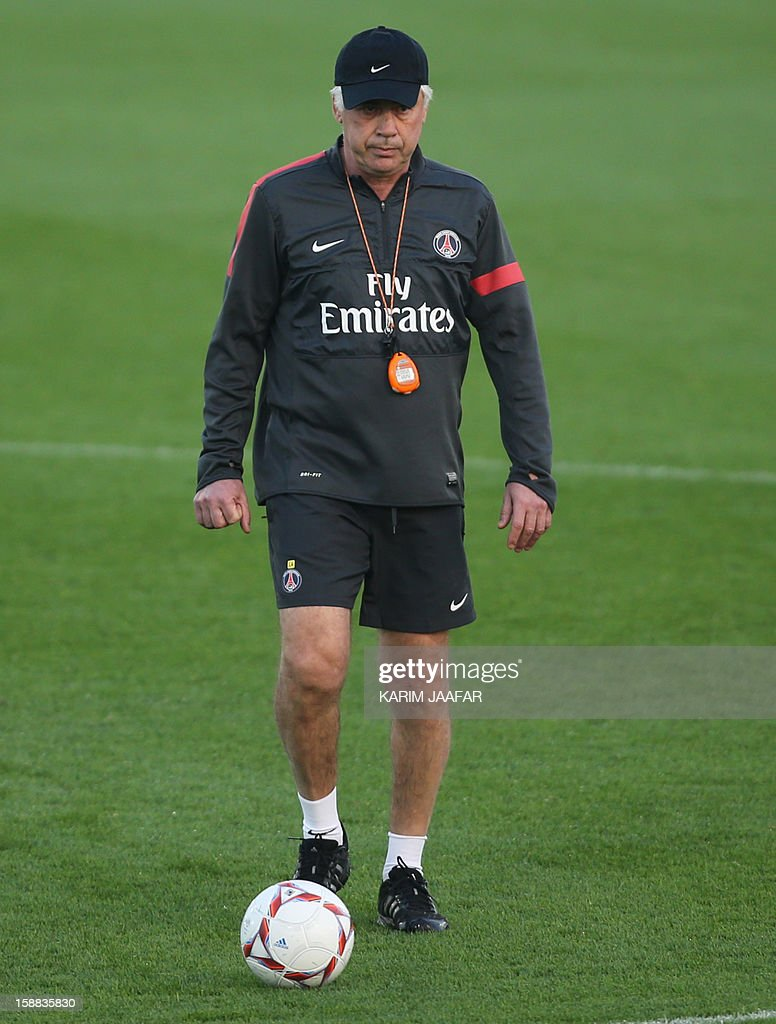 Paris Saint-Germain's (PSG) Italian coach Carlo Ancelotti attends a training session at the Aspire Academy of Sports Excellence in the Qatari capital Doha on December 31, 2012. PSG is in Qatar for a week-long training camp before the resumption of the French Ligue 1 after the winter break.