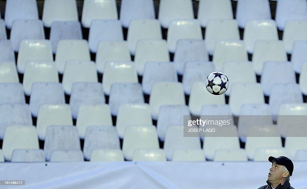 Paris Saint-Germain's Italian coach Carlo Ancelotti eyes the ball during a training session at Mestalla stadium in Valencia on February 11, 2013 on the eve of their UEFA Champions League football match against Valencia.