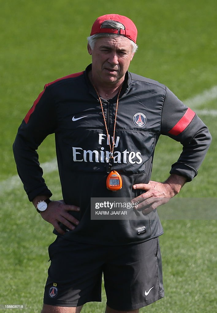 Paris Saint-Germain's (PSG) Italian coach Carlo Ancelotti monitors as his team takes part in a training session at the Aspire Academy of Sports Excellence in the Qatari capital Doha on December 30, 2012. PSG is in Qatar for a week-long training camp before the resumption of the French Ligue 1 after the winter break.