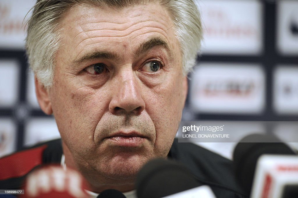 Paris Saint-Germain's Italian coach Carlo Ancelotti speaks during a press conference at the club's training center, le camp des loges, on January 5, 2013 in Saint-Germain en Laye, west of Paris. PSG is to play a French Cup football match against Arras the day after. AFP PHOTO / LIONEL BONAVENTURE
