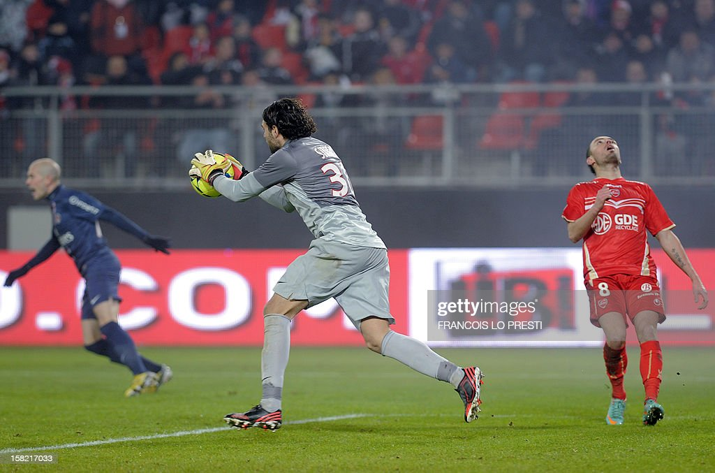 Paris Saint-Germain's Italian goalkeeper Salvatore Sirigu (C) grabs the ball in front of Valenciennes' midfielder Gael Danic (R) during the French L1 football match Valenciennes (VAFC) vs Paris Saint-Germain (PSG) at the Hainaut stadium in Valenciennes, northern France, on December 11, 2012.
