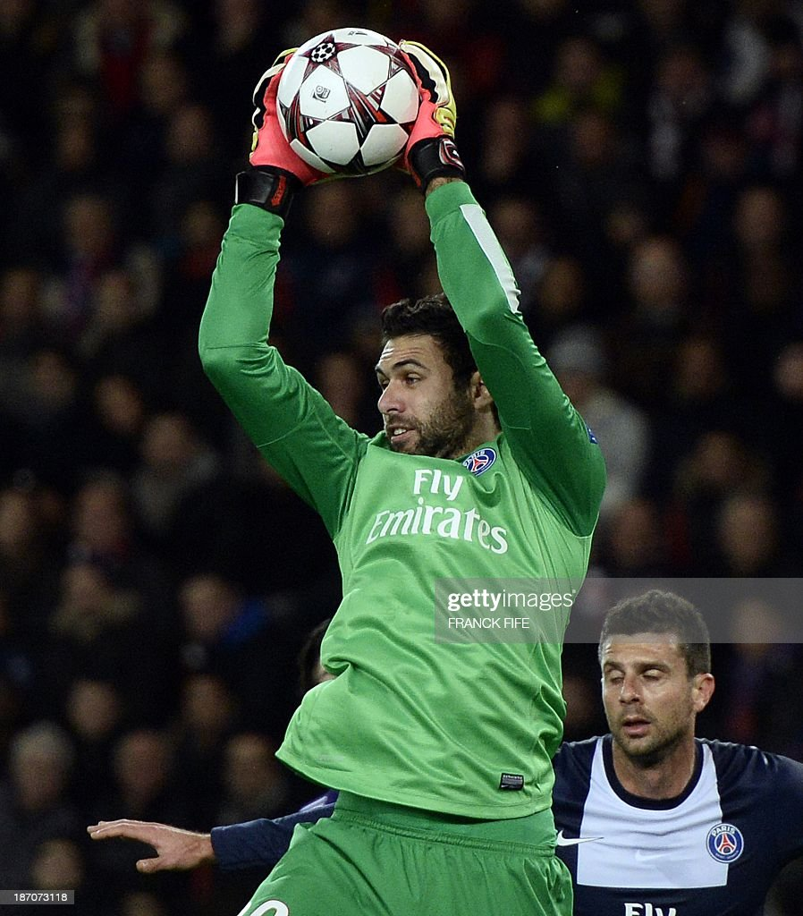 Paris Saint-Germain's Italian goalkeeper Salvatore Sirigu jumps for the bal during the UEFA Champions League football match Paris Saint-Germain (PSG) vs RSC Anderlecht (RSCA) on November 5, 2013 at the Parc des Princes in Paris. The match ended in a draw 1-1.