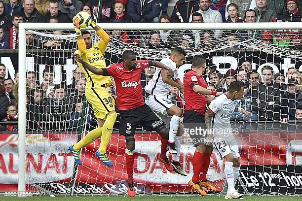 Paris SaintGermain's Italian goalkeeper Salvatore Sirigu saves a goal during the French L1 football match Guingamp vs Paris SG at the Roudourou...