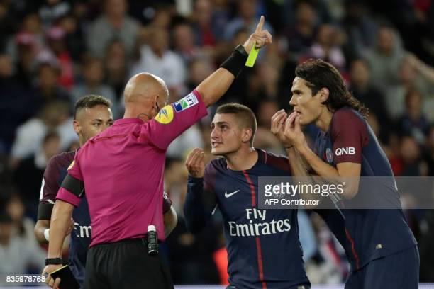 Paris SaintGermain's Italian midfielder Marco Verratti and Paris SaintGermain's Uruguayan forward Edinson Cavani as French referee Amaury Delerue...