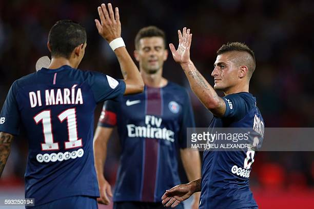 Paris SaintGermain's Italian midfielder Marco Verratti celebrates with his teammate Argentinian midfielder Angel Di Maria after scoring during the...