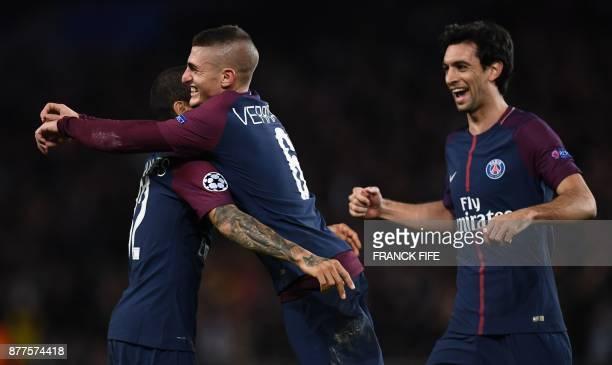 Paris SaintGermain's Italian midfielder Marco Verratti celebrates with teammates after scoring during the UEFA Champions League Group B football...