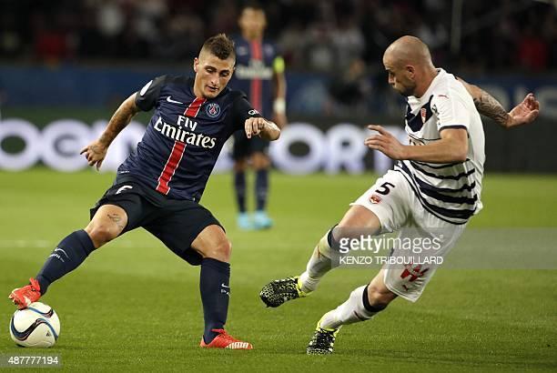 Paris SaintGermain's Italian midfielder Marco Verratti challenges Bordeaux's French defender Nicolas Pallois during the French L1 football match...