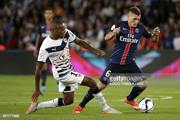 Paris SaintGermain's Italian midfielder Marco Verratti challenges Bordeaux's French midfielder Nicolas MauriceBelay during the French L1 football...