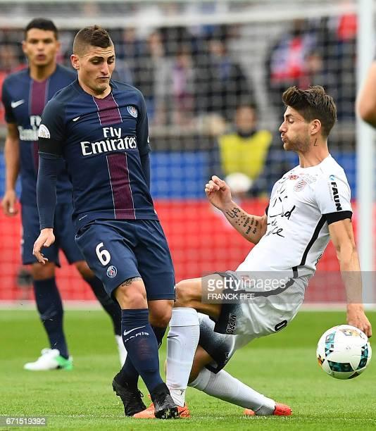 Paris SaintGermain's Italian midfielder Marco Verratti controls the ball next to Montpellier's French midfielder Ryad Boudebouz during the French L1...