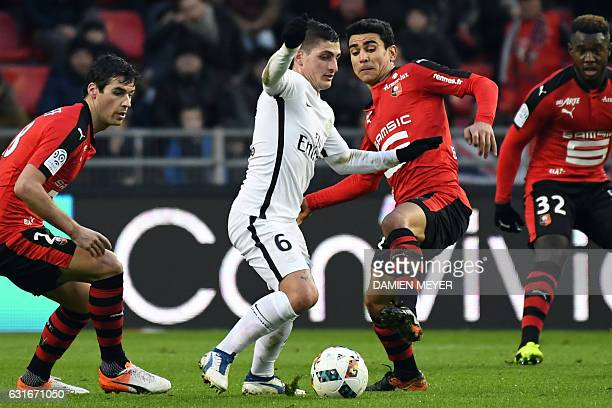 Paris SaintGermain's Italian midfielder Marco Verratti fights for the ball with Rennes' French midfielder Benjamin Andre during the French L1...