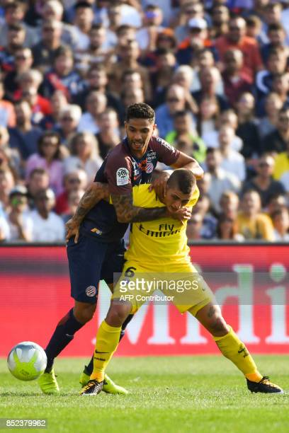 Paris SaintGermain's Italian midfielder Marco Verratti holds off Montpellier's Portuguese defender Pedro Mendes during the French Ligue 1 football...