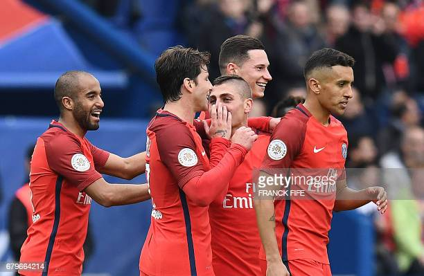 Paris SaintGermain's Italian midfielder Marco Verratti is congratuled by teammates after scoring a goal during the French L1 football match between...