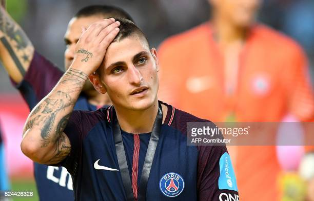 Paris SaintGermain's Italian midfielder Marco Verratti reacts at the end of the French Trophy of Champions football match between Monaco and Paris...