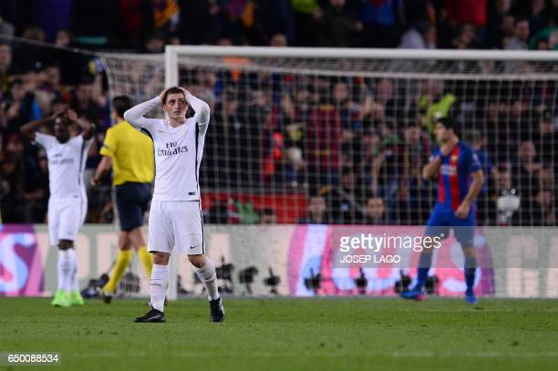 Paris SaintGermain's Italian midfielder Marco Verratti reacts on the pitch after Barcelona's midfielder Sergi Roberto scored his team's victory goal...