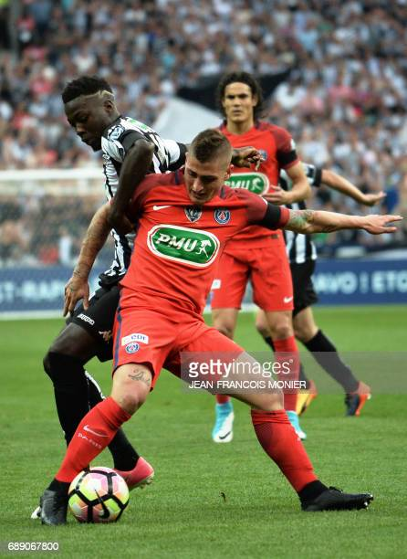Paris SaintGermain's Italian midfielder Marco Verratti vies for the ball with Angers' French forward Nicolas Pepe during the French Cup final...