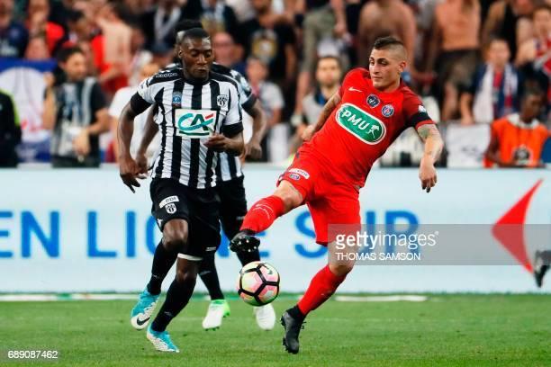 Paris SaintGermain's Italian midfielder Marco Verratti vies for the ball with Angers' Cameroun forward Karl Toko Ekambi during the French Cup final...