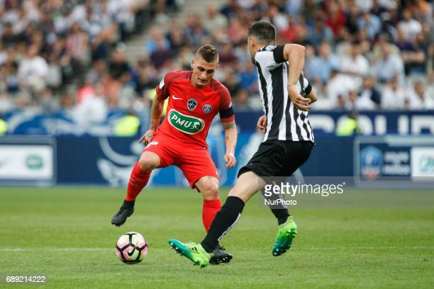 Paris SaintGermain's Italian midfielder Marco Verratti vies with an Anger player during the French Cup final football match between Paris...