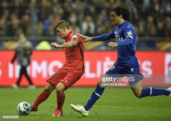 Paris SaintGermain's Italian midfielder Marco Verratti vies with Bastia's French defender FrançoisJoseph Modesto during the French League Cup final...