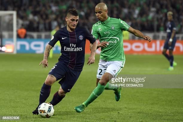 Paris SaintGermain's Italian midfielder Marco Verratti vies with SaintEtienne's French forward Kevin MonnetPaquet during the L1 football match...