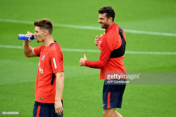 Paris SaintGermain's Italian midfielder Thiago Motta and Paris SaintGermain's Belgian defender Thomas Meunier take part in a training session at the...