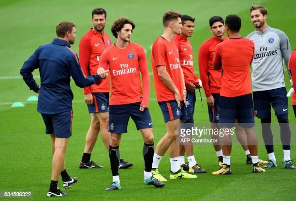 Paris SaintGermain's Italian midfielder Thiago Motta French midfielder Adrien Rabiot German goalkeeper Kevin Trapp and teammates take part in a...