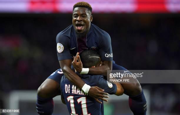 TOPSHOT Paris SaintGermain's Ivorian defender Serge Aurier congratulates Paris SaintGermain's Argentinian forward Angel Di Maria after he scored a...