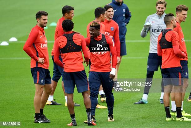 Paris SaintGermain's Ivorian defender Serge Aurier Italian midfielder Thiago Motta and German goalkeeper Kevin Trapp take part in a training session...