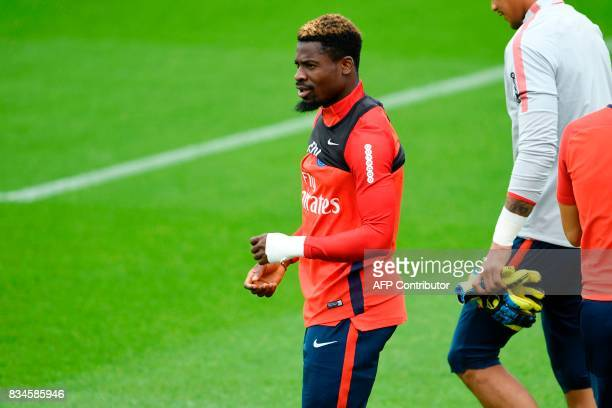 Paris SaintGermain's Ivorian defender Serge Aurier takes part in a training session at the Camp des Loges in SaintGermainenLaye near Paris on August...