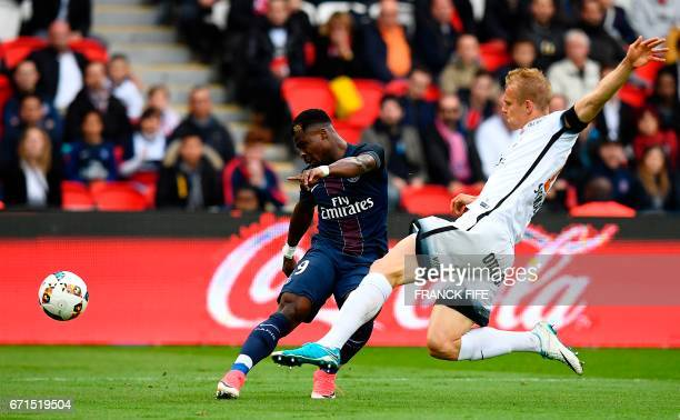 Paris SaintGermain's Ivorian defender Serge Aurier vies with Montpellier's defender Lukas Pokorny during the French L1 football match between Paris...