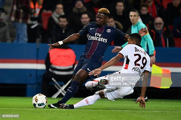 Paris SaintGermain's Ivorian defender Serge Aurier vies with Nice's Brazilian winger Dalbert Henrique during the French L1 football match between...