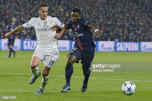 Paris SaintGermain's Ivorian defender Serge Aurier vies with Real Madrid's Spanish midfielder Lucas Vazquez during the UEFA Champions League football...
