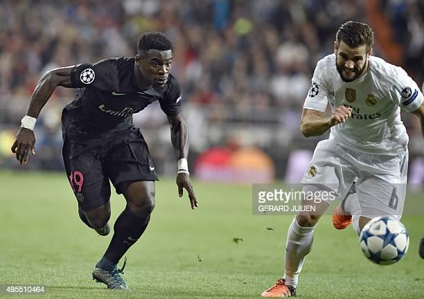 Paris SaintGermain's Ivorian defender Serge Aurier vies with Real Madrid's defender Nacho Fernandez during the UEFA Champions League group stage...