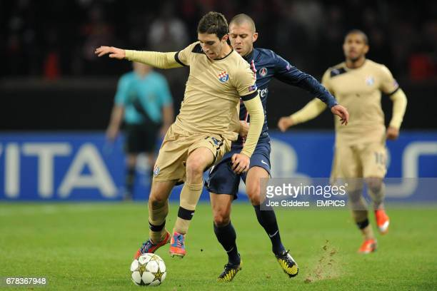 Paris SaintGermain's Jeremy Menez and Dinamo Zagreb's Sime Vrsaljko battle for the ball
