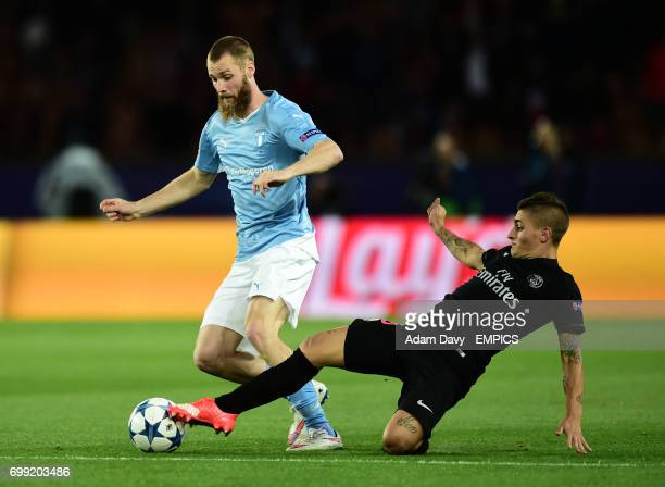 Paris SaintGermain's Marco Verratti and Malmo FF's Jo Inge Berget battle for the ball