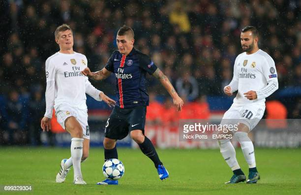 Paris SaintGermain's Marco Verratti holds off Real Madrid's Toni Kroos and Jese