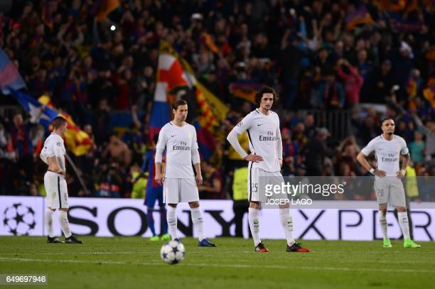 TOPSHOT Paris SaintGermain's midfielder Adrien Rabiot and teammates stand on the pitch after Barcelona's midfielder Sergi Roberto scored his team's...