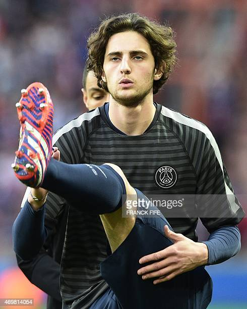Paris SaintGermain's midfielder Adrien Rabiot warms up before the UEFA Champions league quarterfinal first leg football match PSG vs FC Barcelona at...
