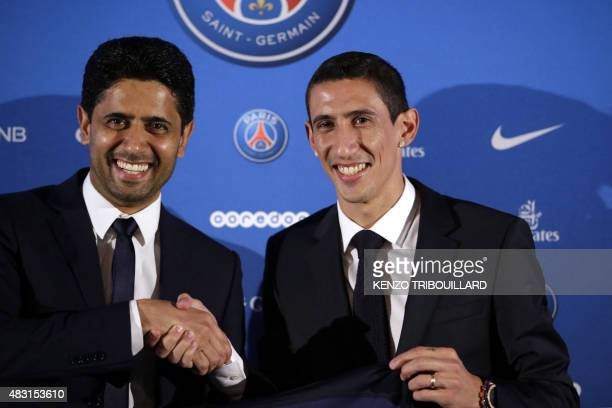 Paris SaintGermain's new Argentinian midfielder Angel Di Maria and Paris SaintGermain's Qatari president Nasser AlKhelaifi shake hands as they pose...