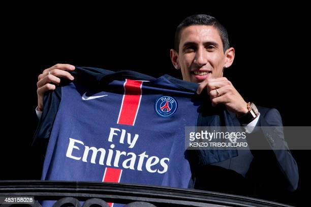 Paris SaintGermain's new Argentinian midfielder Angel Di Maria poses with his PSG jersey on a balcony during his official presentation in Paris on...