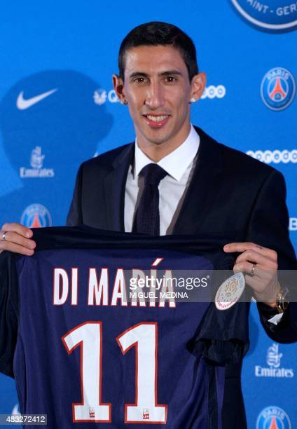 Paris SaintGermain's new Argentinian midfielder Angel Di Maria poses with his PSG jersey during his official presentation in Paris on August 6 2015...