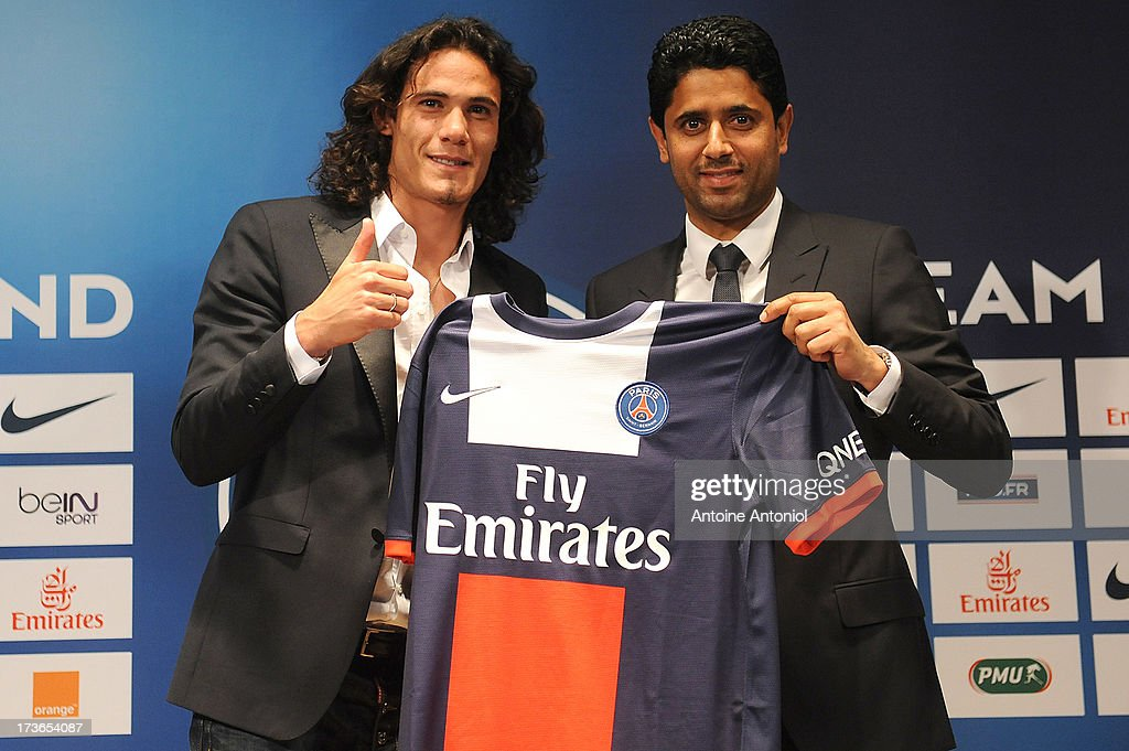 Paris Saint-Germain's (PSG) new forward, <a gi-track='captionPersonalityLinkClicked' href=/galleries/search?phrase=Edinson+Cavani&family=editorial&specificpeople=4104253 ng-click='$event.stopPropagation()'>Edinson Cavani</a> (L), and Paris Saint-Germain's (PSG) chairman Nasser Al-Khelaifi, pose with Cavani's jersey during a press conference on July 16, 2013 in Paris, France. Cavani's transfer to Paris Saint-Germain football club is reported to have cost in the region of £55m.
