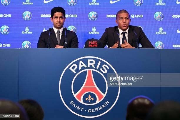 TOPSHOT Paris SaintGermain's new forward Kylian Mbappe speaks as he sits next to Paris Saint Germain's Qatari president Nasser AlKhelaifi during his...
