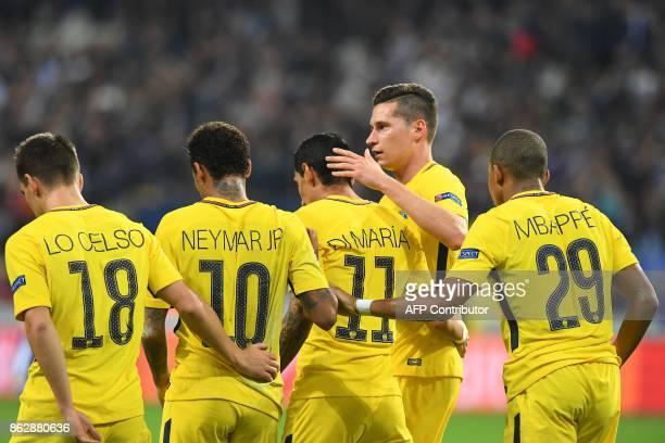 Paris SaintGermain's players celebrat Argentinian forward Angel Di Maria after he scored a goal during the UEFA Champions League Group B football...